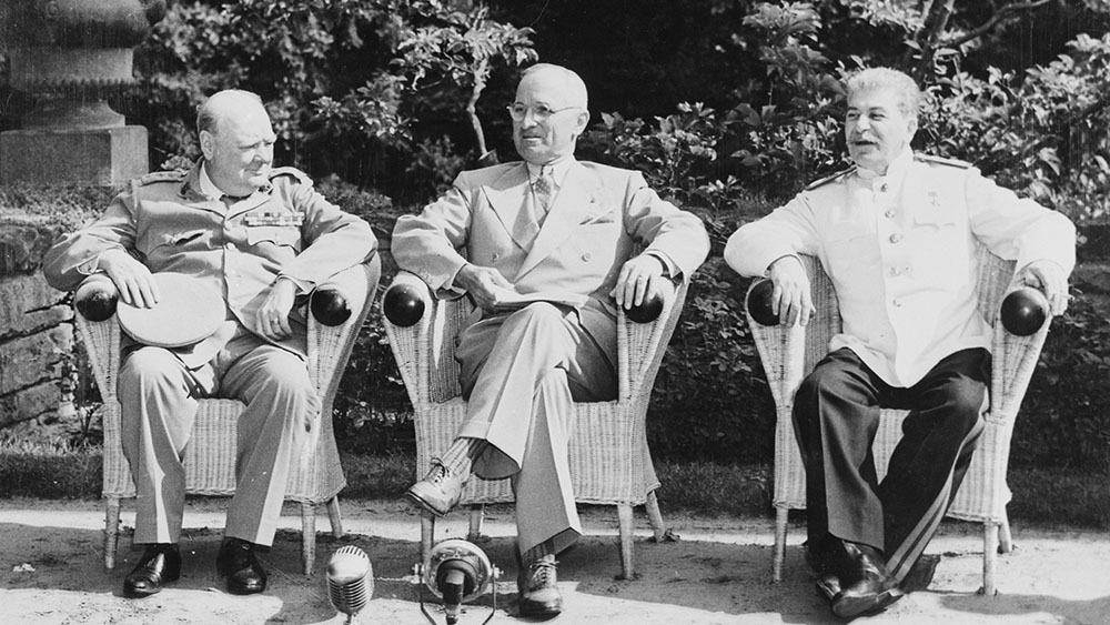 L to R: British Prime Minister Winston Churchill, President Harry S. Truman, and Soviet leader Josef Stalin in the garden of Cecilienhof Palace before meeting for the Potsdam Conference in Potsdam, Germany.